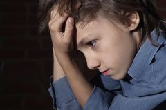 Caucasian child frustrated sitting Royalty Free Stock Photography