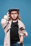 Caucasian child girl in glasses and oversized coat looking away Stock Photography