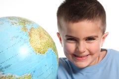 Caucasian child with globe. On white background royalty free stock image