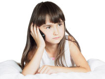 Caucasian child kid girl sister lying on the bed with mobile phone isolated Stock Photos