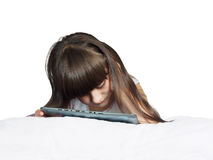 Caucasian child kid girl sister lying on the bed with tablet pc isolated Royalty Free Stock Images