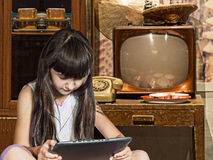 Caucasian child kid girl sister in old home with tablet pc Stock Image