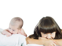 Caucasian child sister and baby brother lying together isolated on white Royalty Free Stock Photo