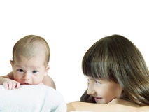 Caucasian child sister and baby brother lying together isolated Stock Photo