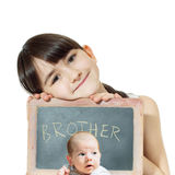 Caucasian child sister holding chalkboard and baby brother face isolated Royalty Free Stock Image