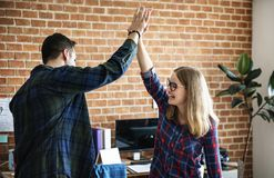 Caucasian colleagues give each other high five Royalty Free Stock Photography