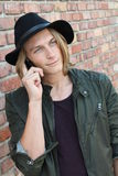 Caucasian college boy talking on mobile phone.  Royalty Free Stock Photos