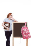 Caucasian college student backpack by blackboard. Education series - Friendly Caucasian female high school student with backpack by blank blackboard with copy Stock Photos