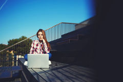 Caucasian college student studying with laptop computer at campus Stock Photos