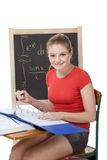 Caucasian college student woman studying math exam. High school or college female student sitting by the desk at math class. Blackboard with advanced Royalty Free Stock Photo