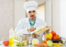 Caucasian cook does veggie lunch Royalty Free Stock Photo