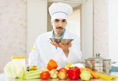 Caucasian cook in uniform with plate Stock Images