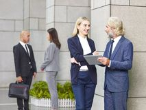 Corporate business people standing talking Stock Photos