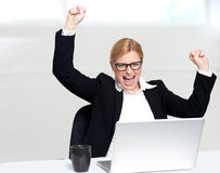 Caucasian corporate woman enjoying success Stock Photos