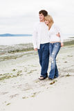 Caucasian couple on the beach Stock Photo