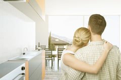 Caucasian couple in bright kitchen Royalty Free Stock Images