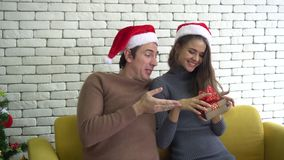 Caucasian couple celebrating Christmas selfie and surprise gift. 4k stock footage
