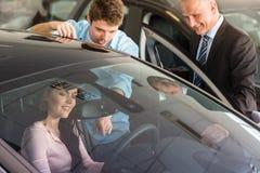 Caucasian couple choosing car Stock Photos