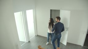Caucasian couple climbs the stairs and looks around at a new apartment. Caucasian couple climbs the stairs and looks around at a new apartment stock video