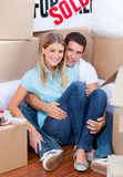 Caucasian couple embracing after move in Stock Photography