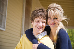Caucasian couple in front of house Stock Photo