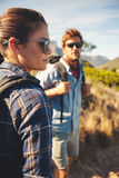 Caucasian couple hiking in nature Stock Photos