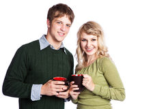 Caucasian couple holding coffee cups Royalty Free Stock Images