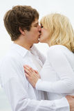 Caucasian couple kissing Stock Photography