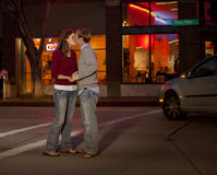 Caucasian couple kissing in street Stock Images