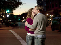 Caucasian couple kissing in street stock photography
