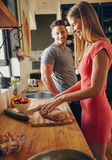 Caucasian couple in the kitchen preparing breakfast Stock Photos