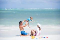 Caucasian couple with little son having fun Stock Photos