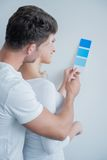 Caucasian Couple Looking at Color Indicator Paper Royalty Free Stock Image