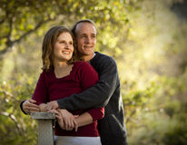 Caucasian couple in love on outdoor wooden bridge royalty free stock photography