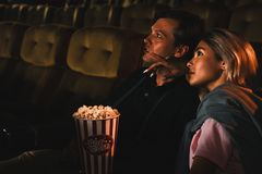 Free Caucasian Couple Lovers In Romance Moment Together Watching Love Story Movie In Theater With Bucket Of Popcorn Royalty Free Stock Photo - 161733005
