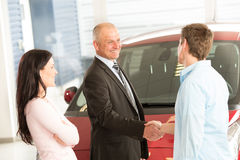 Caucasian couple purchasing a car. In showroom Royalty Free Stock Photography