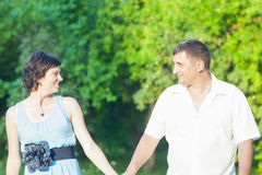 Caucasian Couple Relaxing Outdoors. Walking Had in Hand Together. Holiday and Vacation Concepts Royalty Free Stock Photography