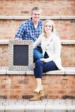 Caucasian couple sitting on brick steps Stock Image