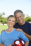 Caucasian Couple With Soccer Ball Royalty Free Stock Photography