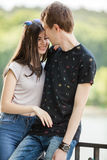 Caucasian couple taking a walk in the park. Lifestyle and relationship. Young inlove boyfriend and girlfriend Stock Images