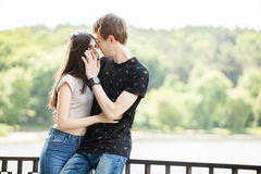 Caucasian couple taking a walk in the park. Lifestyle and relationship. Young inlove boyfriend and girlfriend Royalty Free Stock Photography