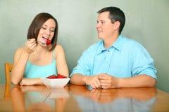 Caucasian Couple Talking On Kitchen Table Stock Image