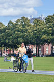 Caucasian couple walks on a sunlit Museum Square, Amsterdam, Netherlands Royalty Free Stock Images