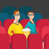 Caucasian couple watching 3D movie in the theatre. Stock Image