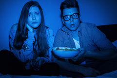 Caucasian couple watching scary movie Royalty Free Stock Photos