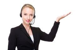 Caucasian customer services operator with hand presentation Stock Photos