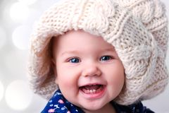 Caucasian cute baby girl portrait in knitted hat. stock photos