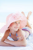 Caucasian cute child lying down on deckchair of beach resort Royalty Free Stock Photos
