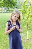 Caucasian cute girl in blue dress stock photography