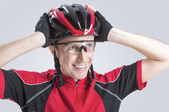 Caucasian Cyclist Checking Road Helmet Royalty Free Stock Images